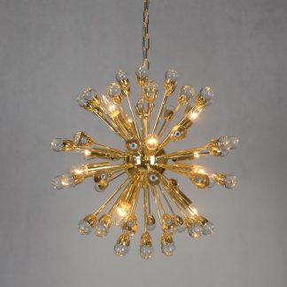 круглый золотой светильник с каплями